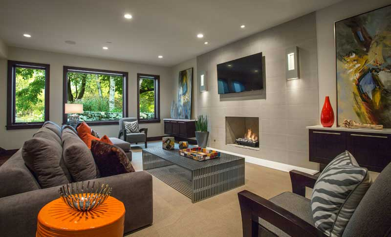 living room with wall sconces and recessed lighting fixtures