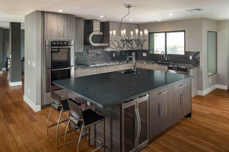 gray kitchen with light bulb chandelier
