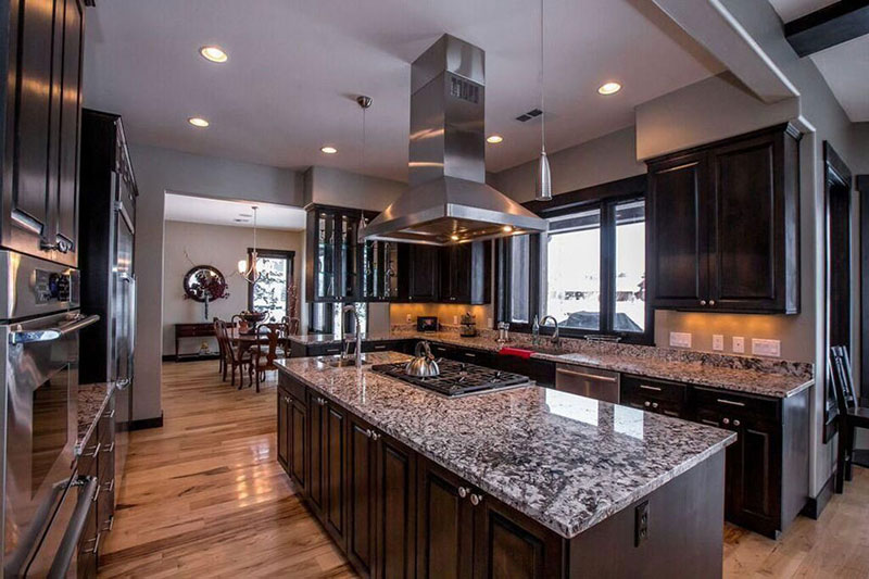 Exceptional Dark Kitchen Cabinets And White Wave Granite Countertops