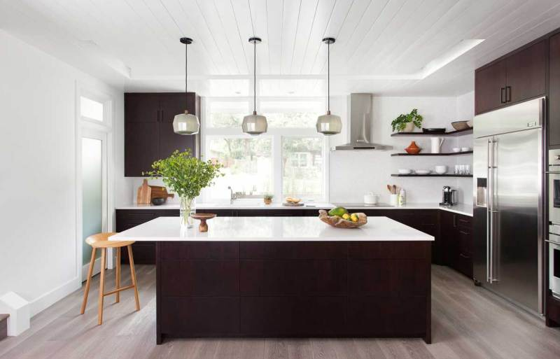 brown kitchen with polished nickel mini pendant light