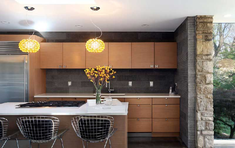 kitchen with yellow glass pendant lights