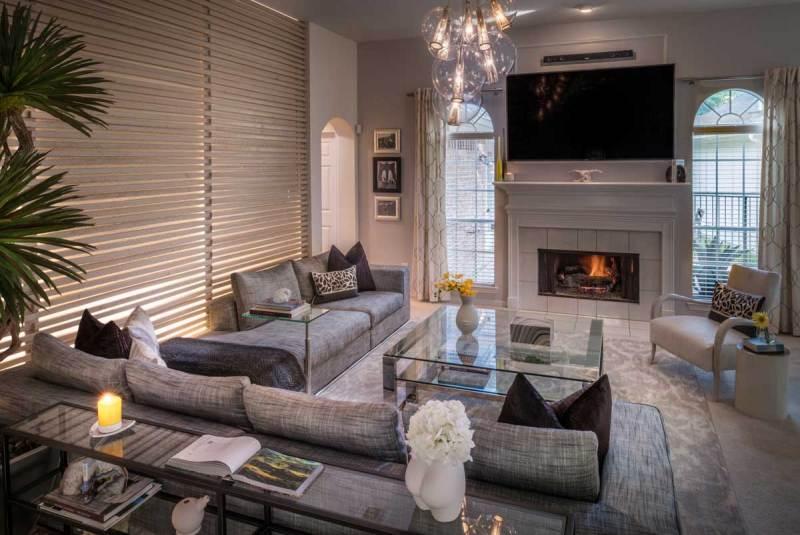 living room with glass globe pendant light fixture
