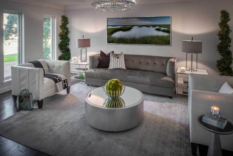 living room with glass drop crystal chandelier