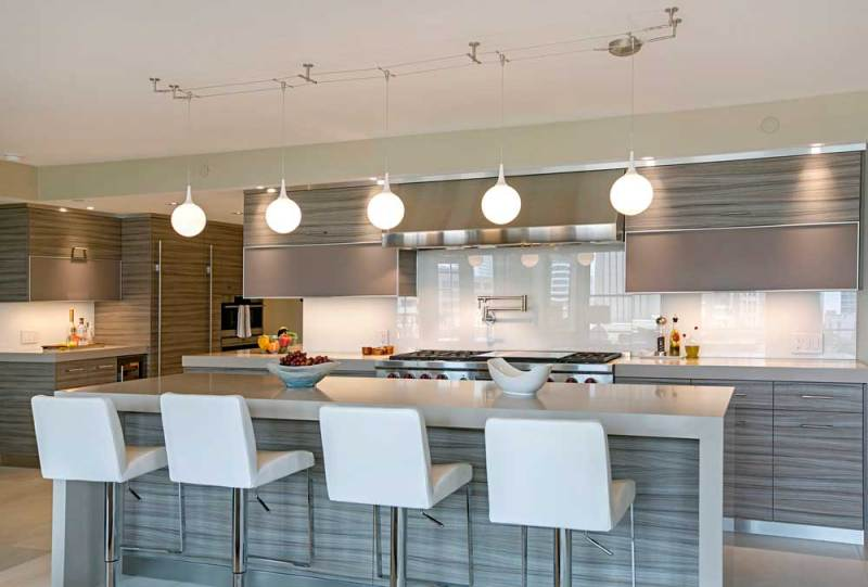 kitchen with globe pendant track lighting