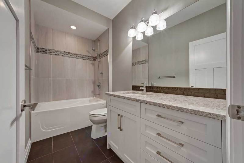 Transitional small bathroom with wall sconces lighting