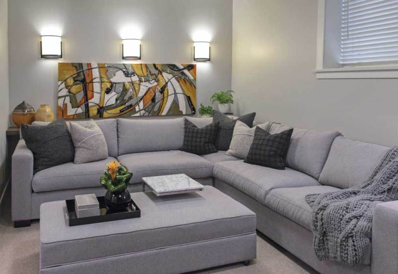 gray living room with wall sconces lighting fixtures