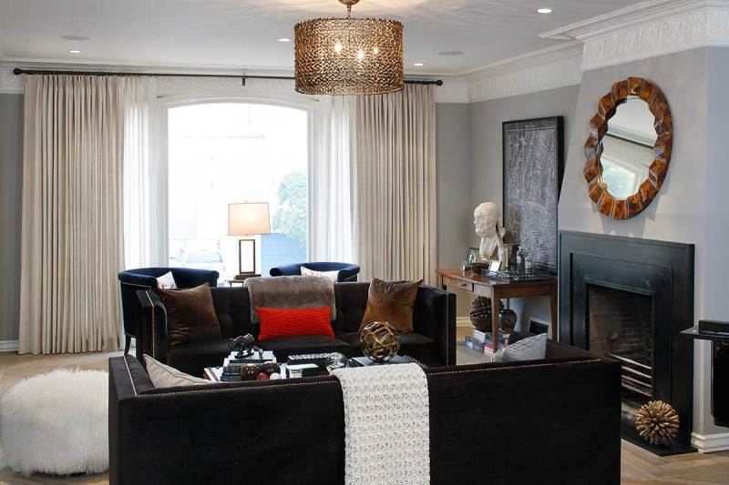 black living room with gold drum pendant light