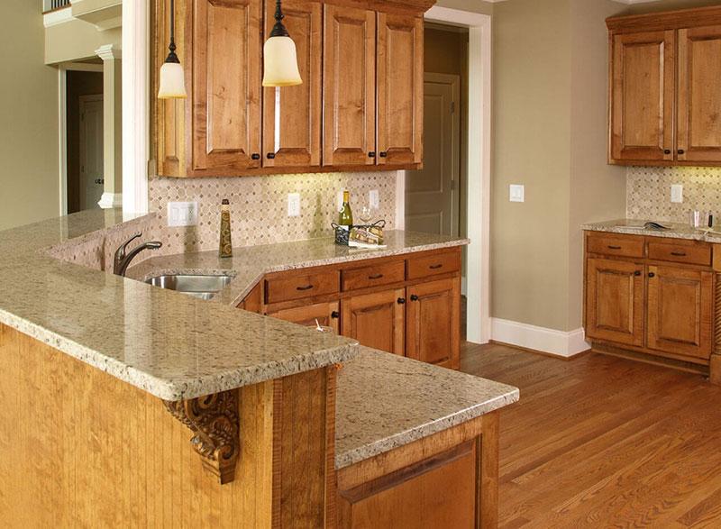 Giallo Ornamental Granite Countertops (Pictures, Cost ... on Granite Countertops With Maple Cabinets  id=45336