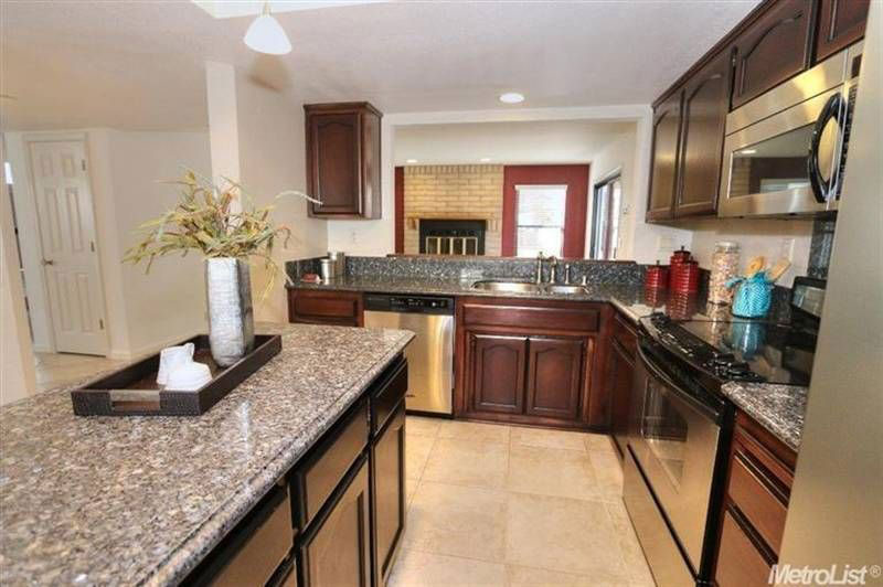 Dark cabinets with new caledonia granite countertops