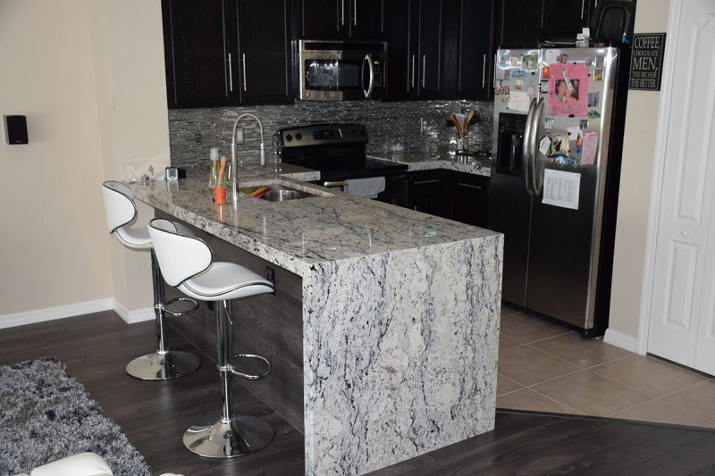 Black cabinets with white ice granite