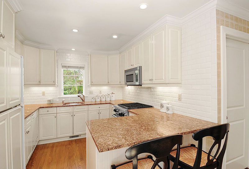 white kitchen cabinets with new venetian gold granite new venetian gold granite countertops elegance gold granite 29036