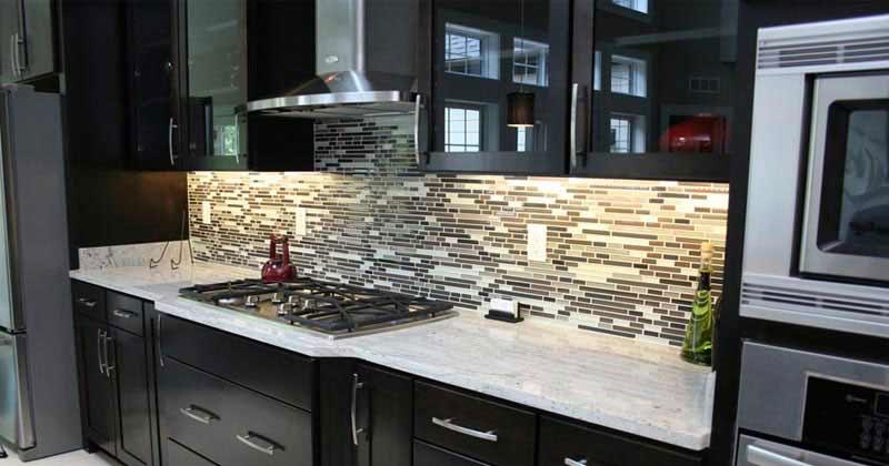 Dark kitchen cabinets with river white granite
