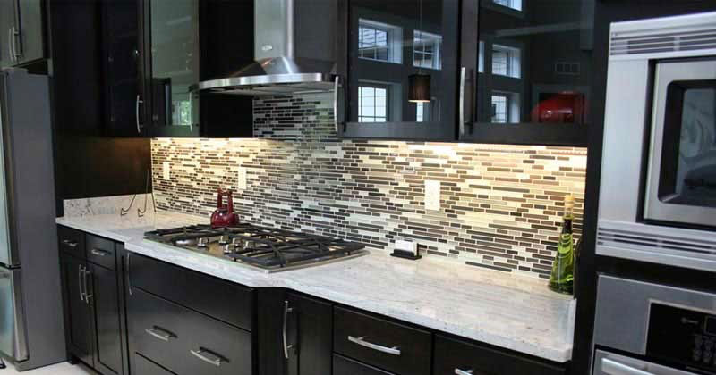 Dark Kitchen Cabinets With River White Granite