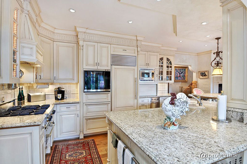 Traditional kitchen with Kashmir white granite countertops