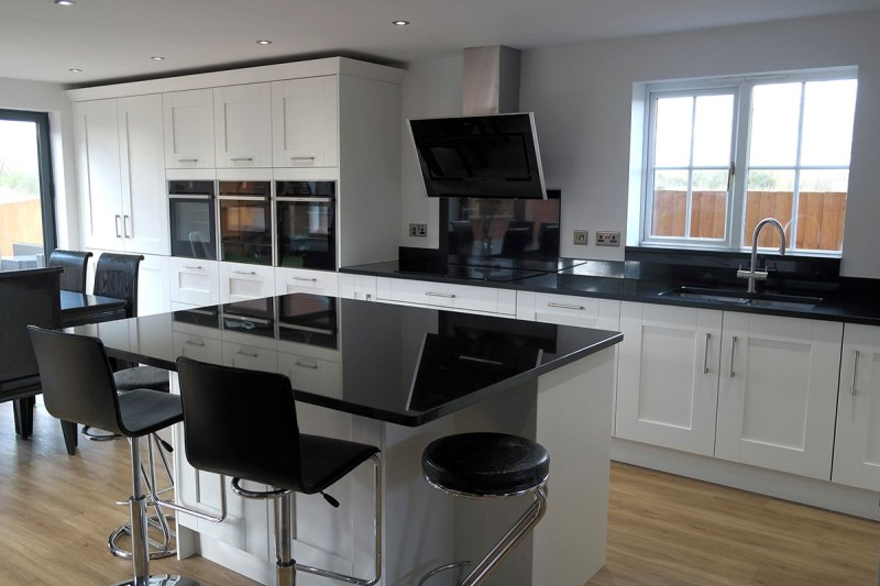 Best Black Granite Countertops (Pictures, Cost, Pros & Cons) on Kitchens With Black Granite Countertops  id=24045