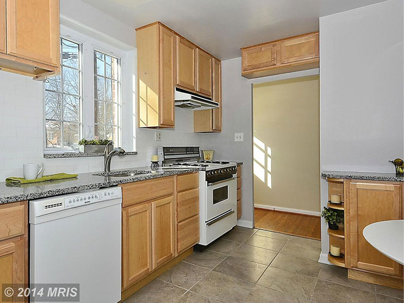 New Caledonia Granite Countertops (Pictures, Cost, Pros ... on Maple Cabinets With White Granite Countertops  id=28297