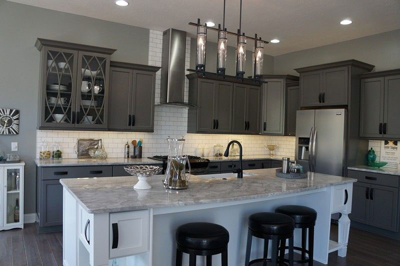 Gray cabinets with river white granite