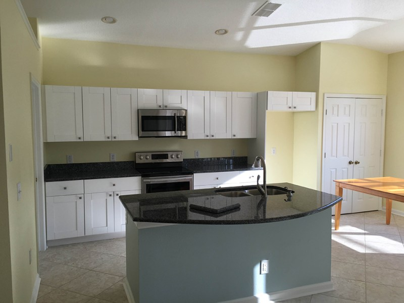 White kitchen with blue pearl royal granite