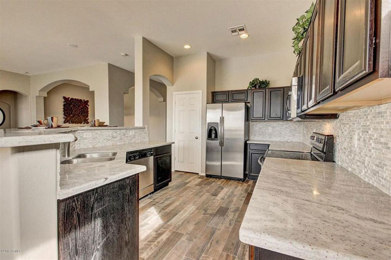 Traditional kitchen with river white granite