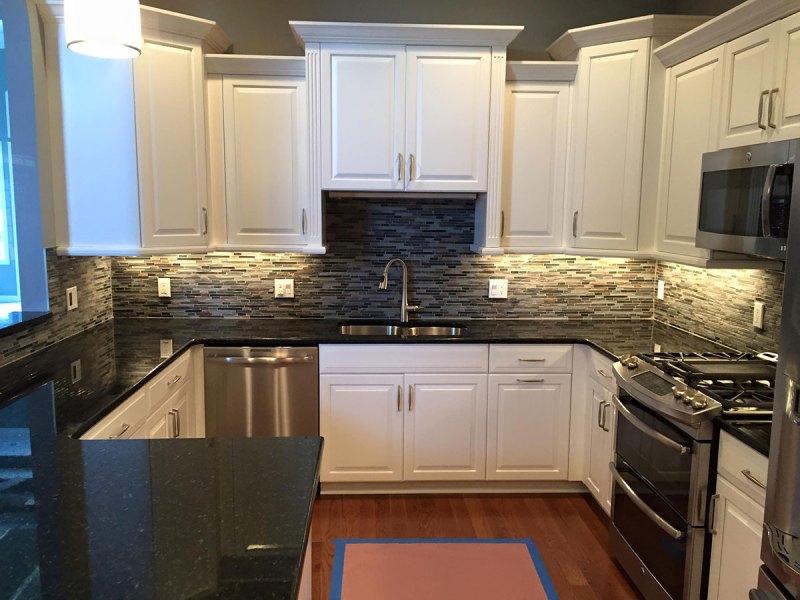 White Kitchen Cabinets With Uba Tuba Granite
