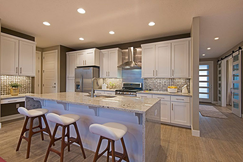 White kitchen with white ice granite