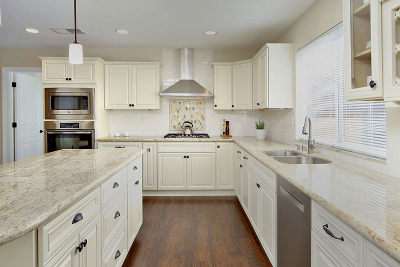 River White Granite With White Cabinets
