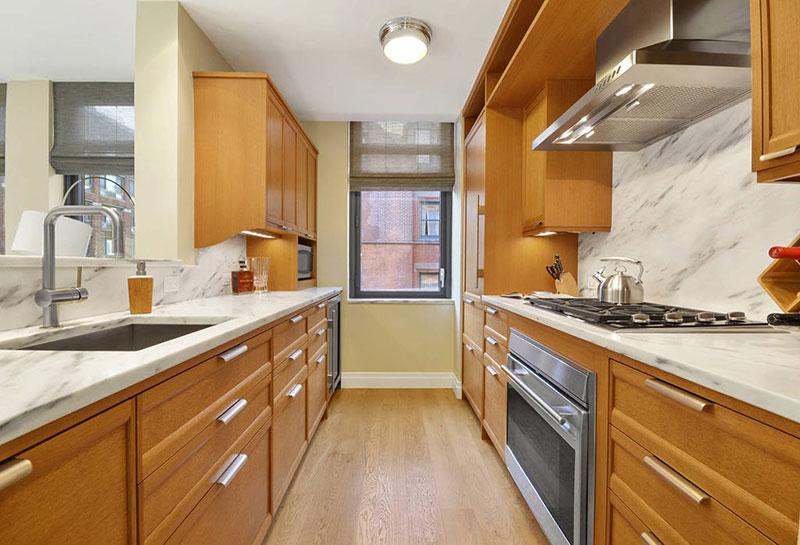Contemporary kitchen with river white granite