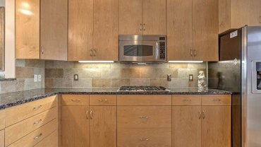Modern kitchen with new caledonia granite countertops