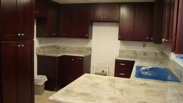 Kashmir white granite with cherry shaker cabinets