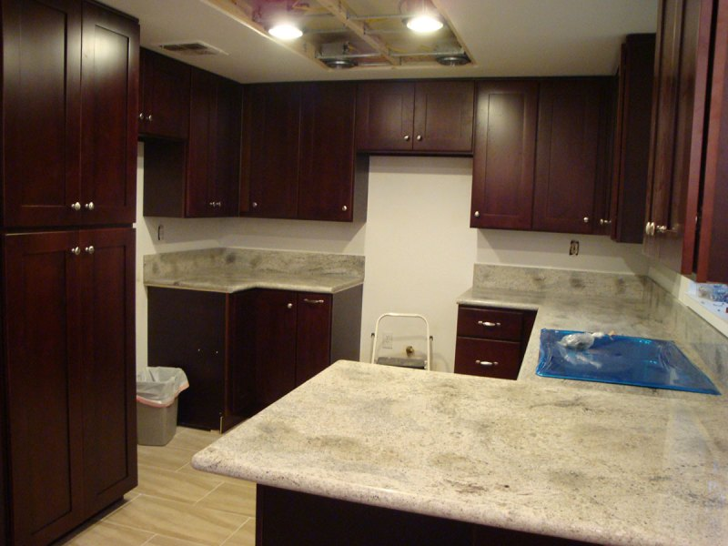 Kashmir white granite with cherry shaker cabinets