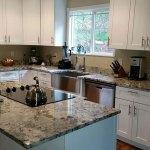 New caledonia granite and white cabinets
