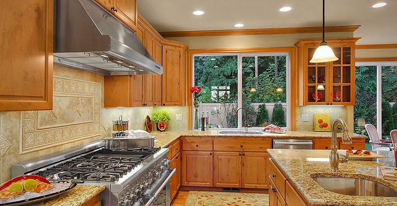 Giallo Ornamental Granite Countertops (Pictures, Cost ... on What Color Granite Goes With Honey Maple Cabinets  id=67596