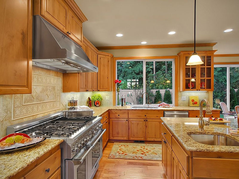 Giallo Ornamental Granite Countertops (Pictures, Cost ... on What Color Granite Goes With Honey Maple Cabinets  id=76205