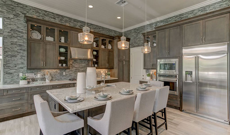 Ttransitional kitchen with bianco romano granite