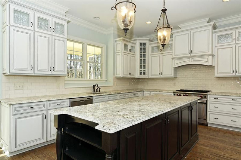 Eclectic kitchen with bianco romano granite countertops
