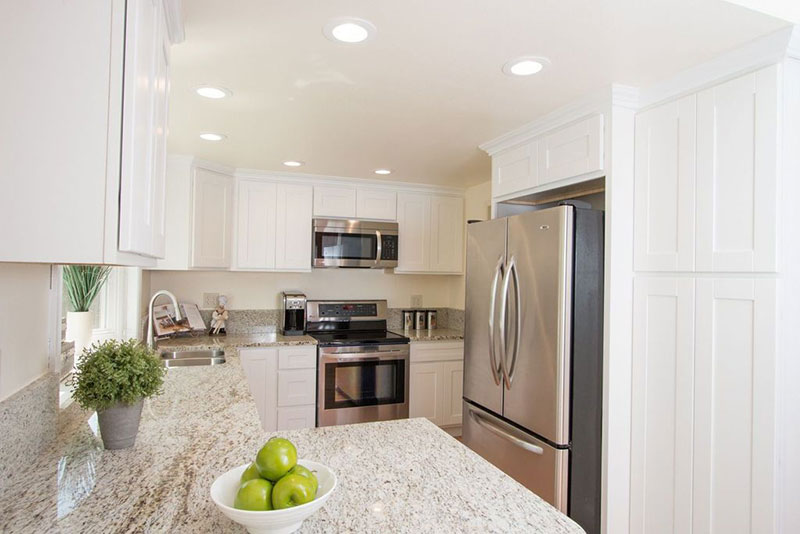 Giallo ornamental light granite white cabinets