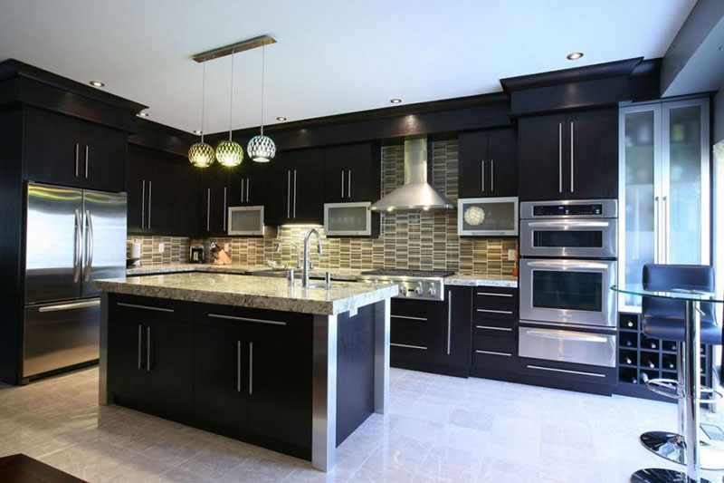 Black Kitchen With Bianco Antico Granite Countertops With Tile Backsplash