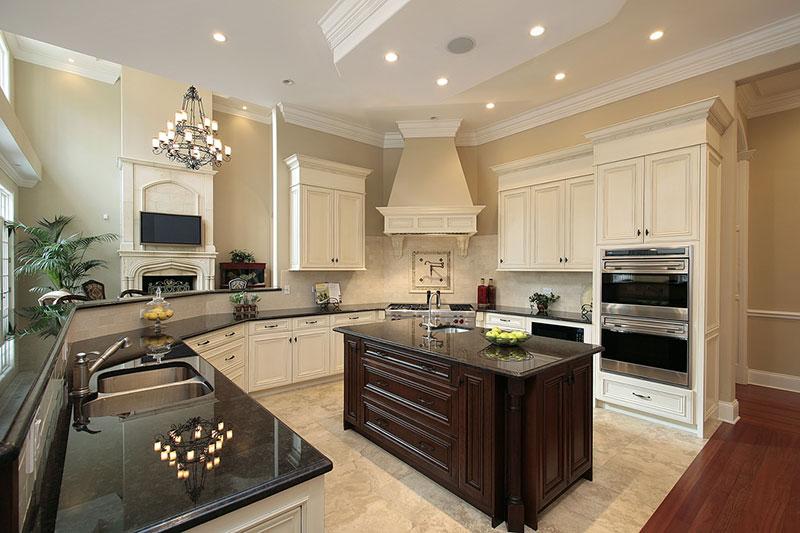 Cream kitchen cabinets with uba tuba granite