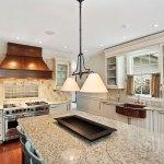 Giallo ornamental granite with antique white cabinets