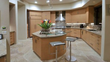 Modern kitchen with bianco romano granite countertops