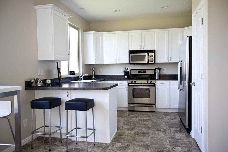 white and gray granite kitchen. black granite with white kitchen cabinets and gray