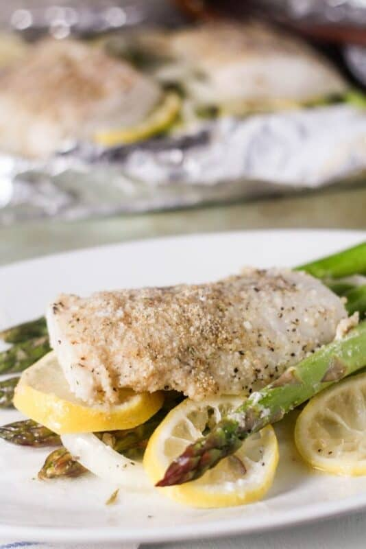 roasted lemon code with asparagus in foil x