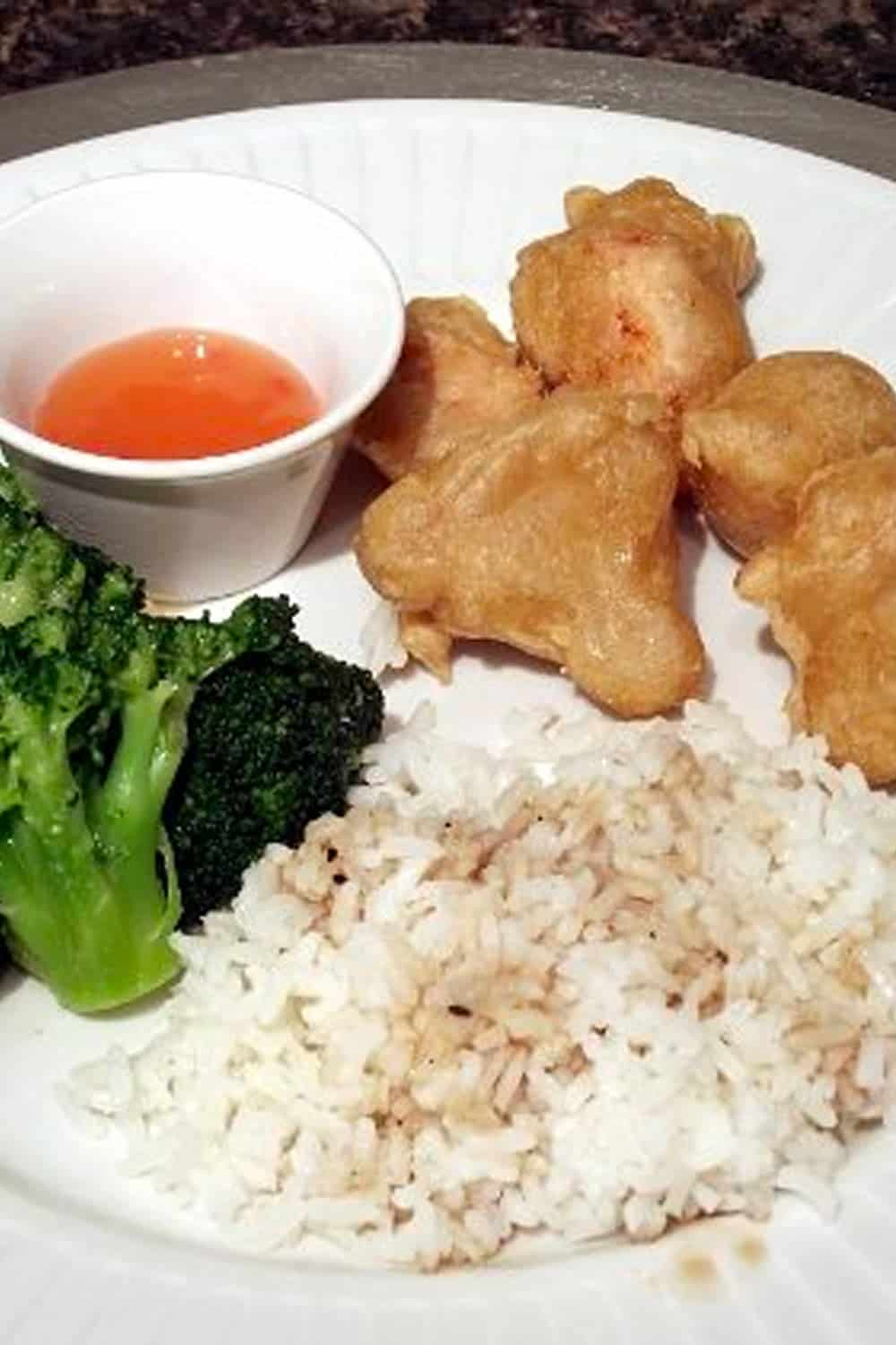 broccoli and chicken balls on a plate with rice