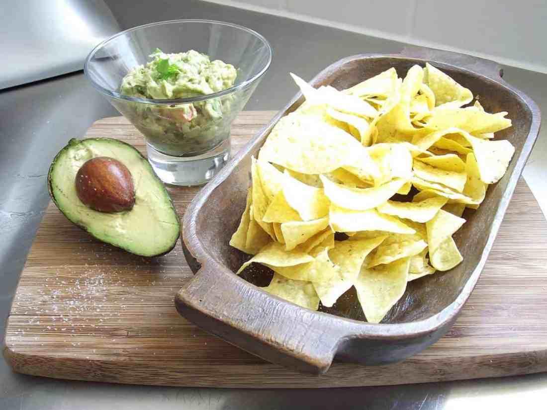 corn chips, guacamole, half an avocado