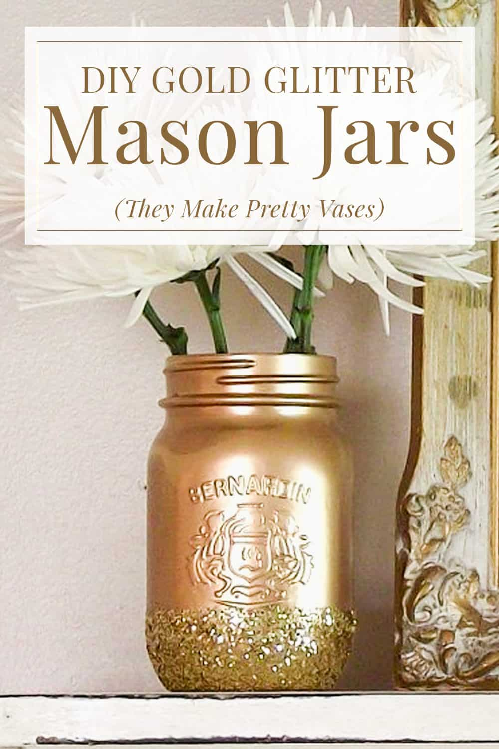 gold and gold glitter mason jar with white flowers inside