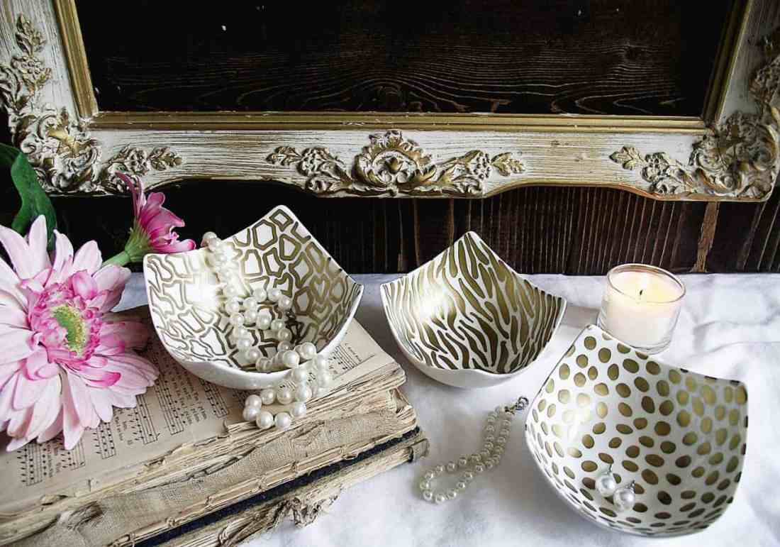 animal prints in gold sharpie on white ceramic dishes