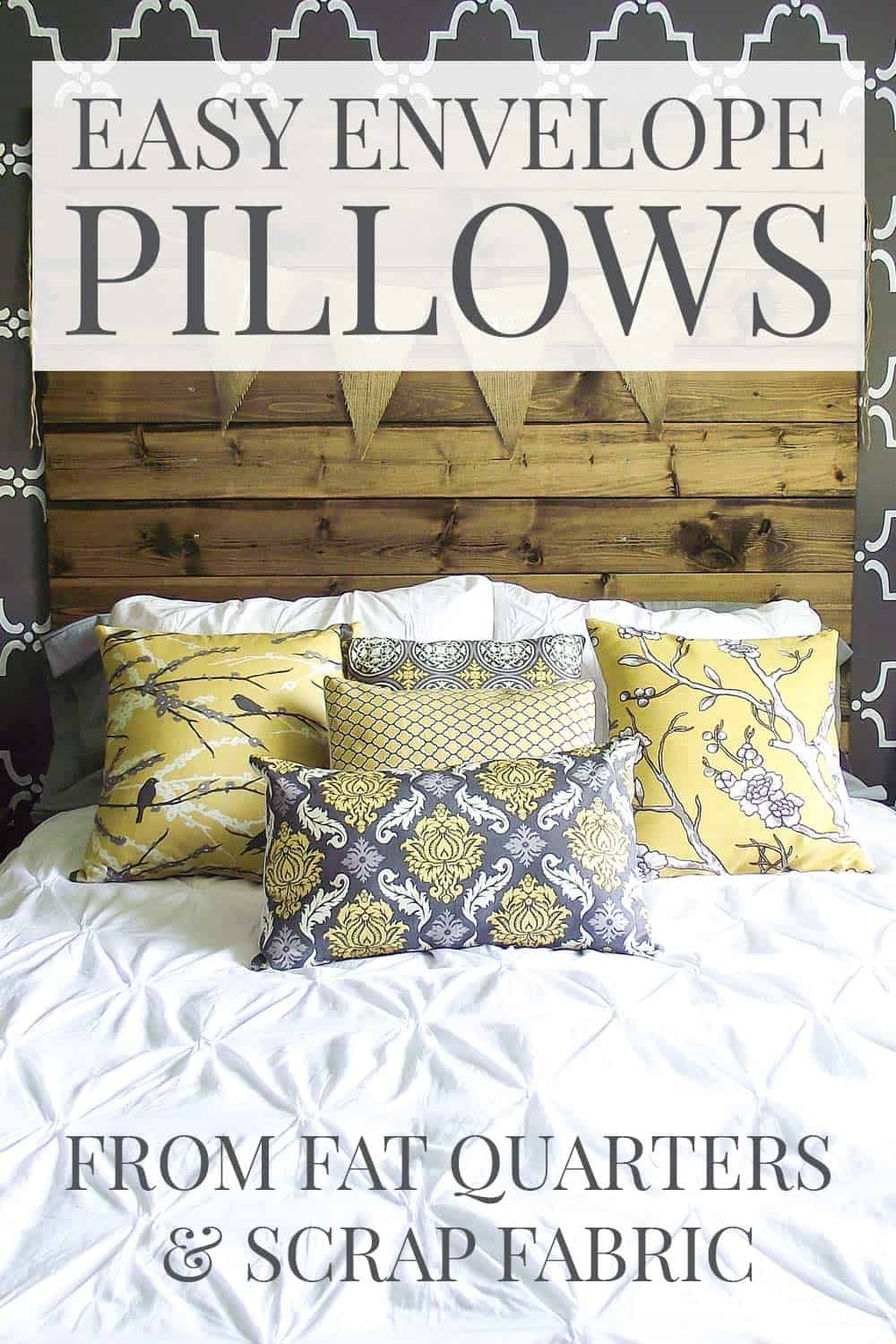 yellow and grey pillows on a bed with white duvet