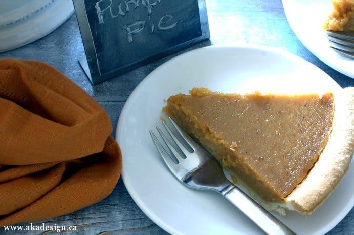 pumpkin pie slice on white plate 1