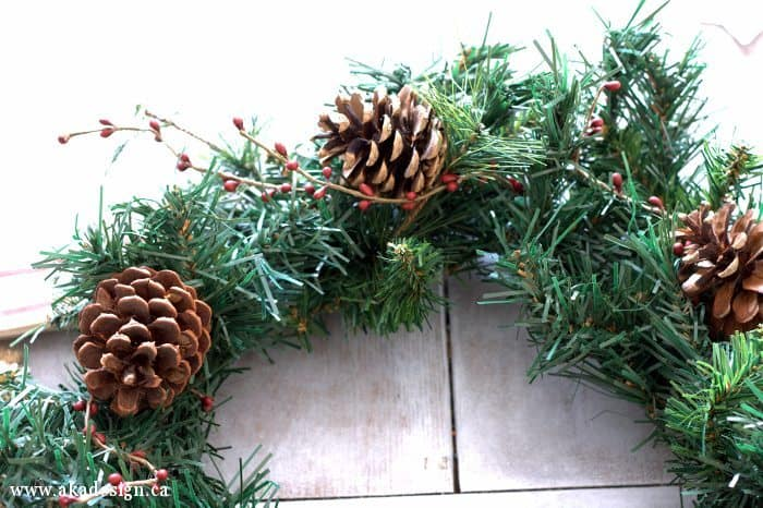 pinecone and rusty jingle bell wreath pine cones