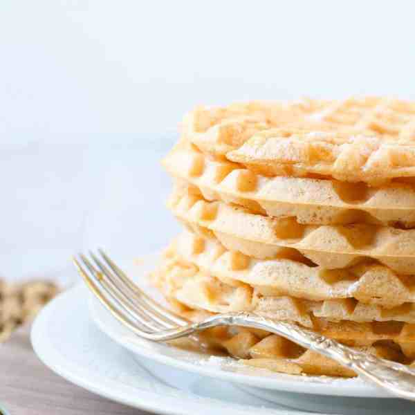 stack of waffles on a plate with antique fork